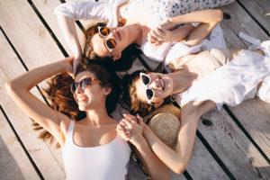 Three women happy at Blaine's beach