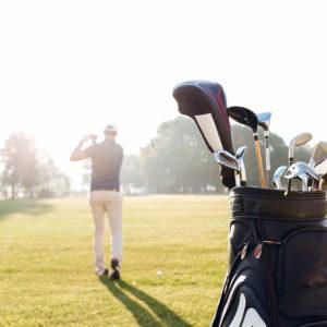 Back view of a male golfer swinging golf club in Blaine, Washington