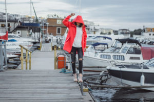 young woman in red cloak enjoying Blaine Harbor