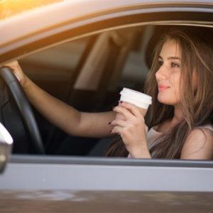 girl enjoying drive thru coffee
