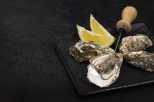 Oysters plate with knife lemon slices in Blaine