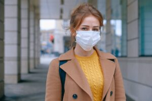 COVID-19 precautions by a woman in a mask