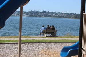 Family sitting in Blaine, WAshington and enjoying the ocean