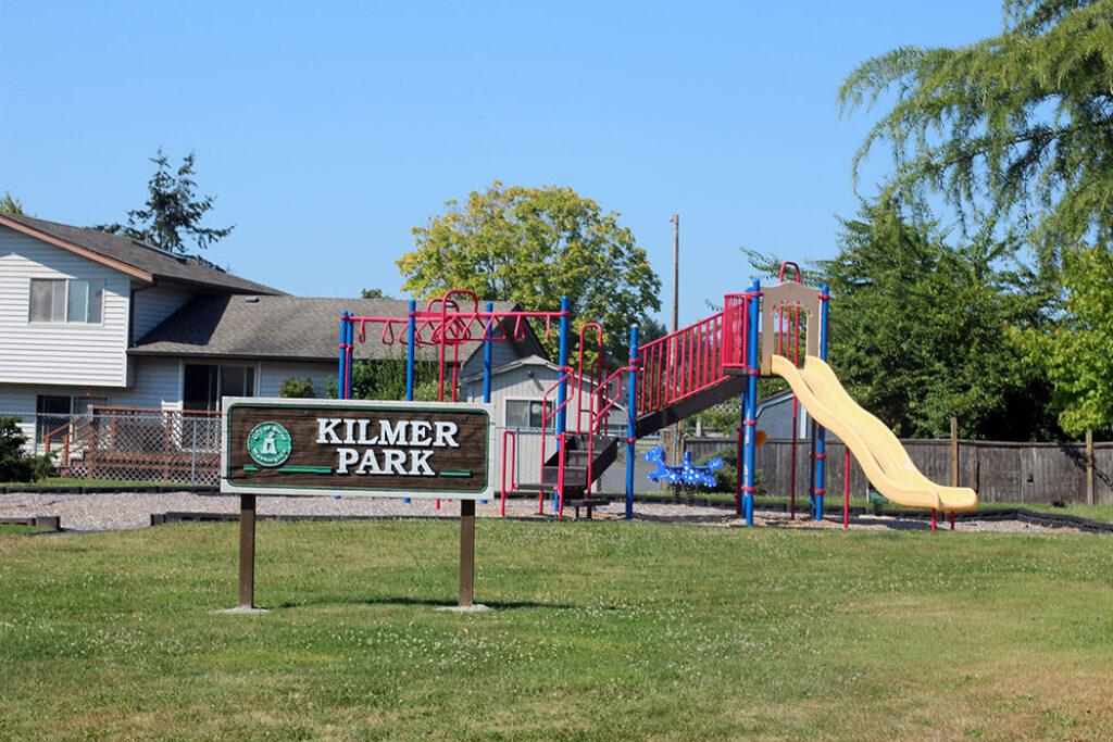 Kilmer Park playground with sign in blaine