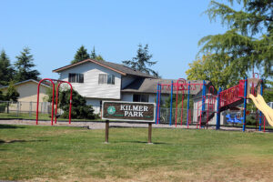 Kilmer Park playground with swing in blaine and signage