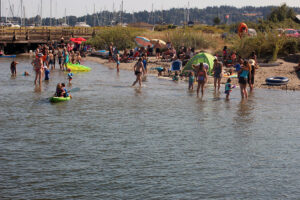 Swimmers gathered at Semiahmoo Spit swimming area in Blaine, Washington