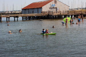 swimmers and kayakers gather at semiahmoo swimming area in Blaine