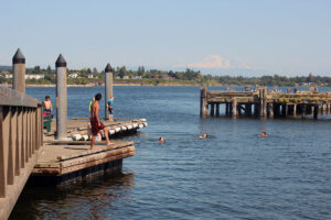 Swimmers jumping off dock at Semiahmoo