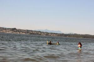 children swimming in Blaine, WA at Semiahmoo Spit