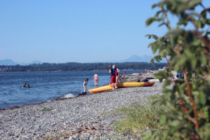 Kayakers prepare to paddle on the beach next to Semiahmoo Spit