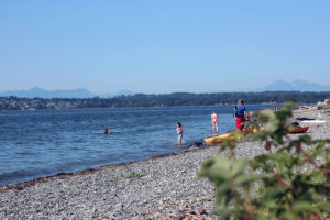 Kayakers prepare to paddle on the beach next to Semiahmoo Spit in Blaine