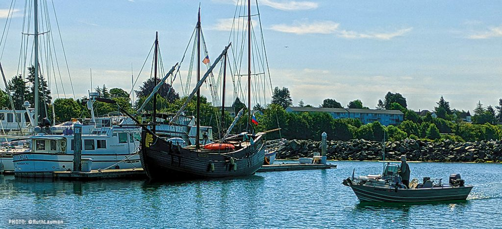 A 18th Century replica of a russian wooden boat sits in Blaine Marina in July 2021